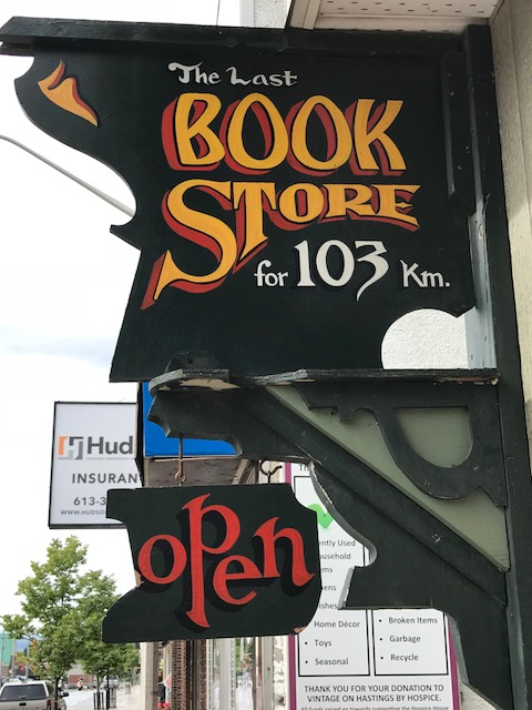 An outdoor store sign for a book store.