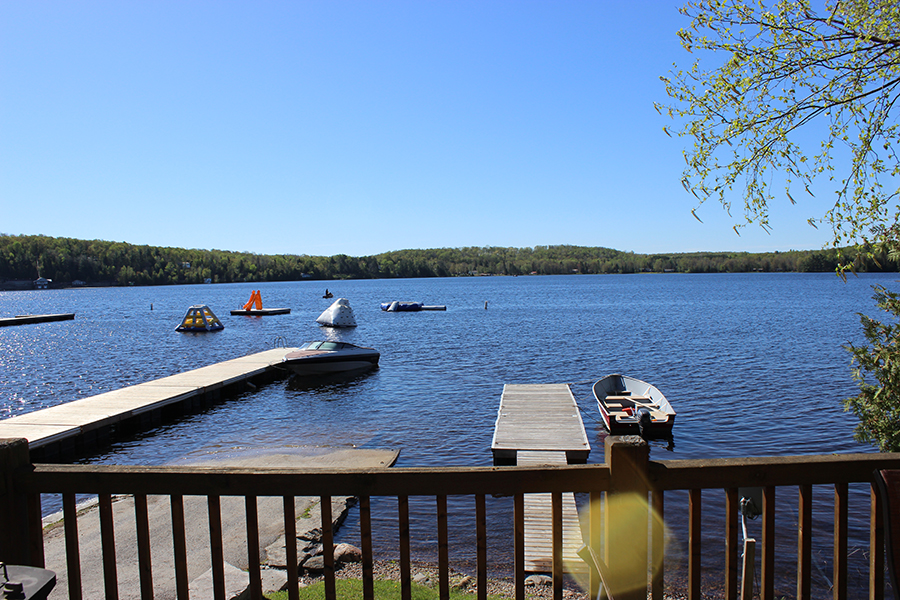 Photo from a dock at Red Eagle Campground looking out over Wollaston Lake with docks in the foreground