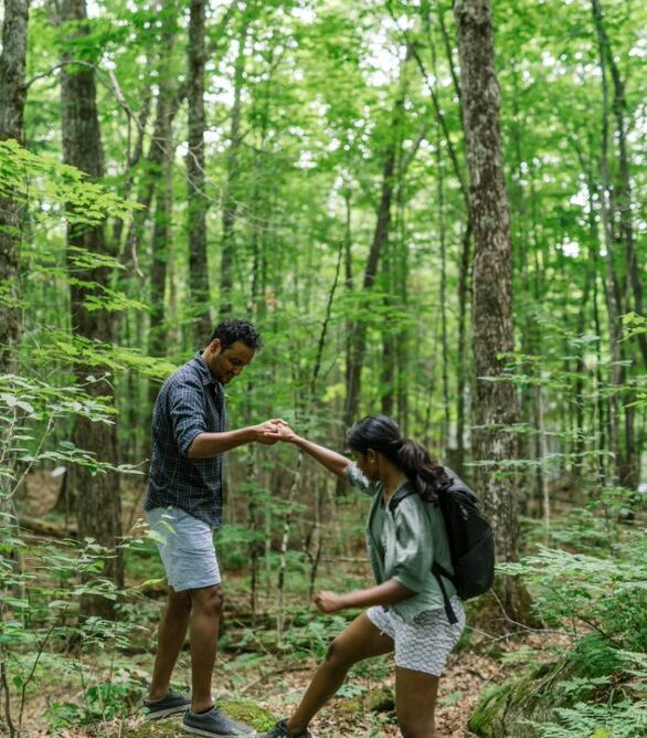 Woman and a man hiking in the woods