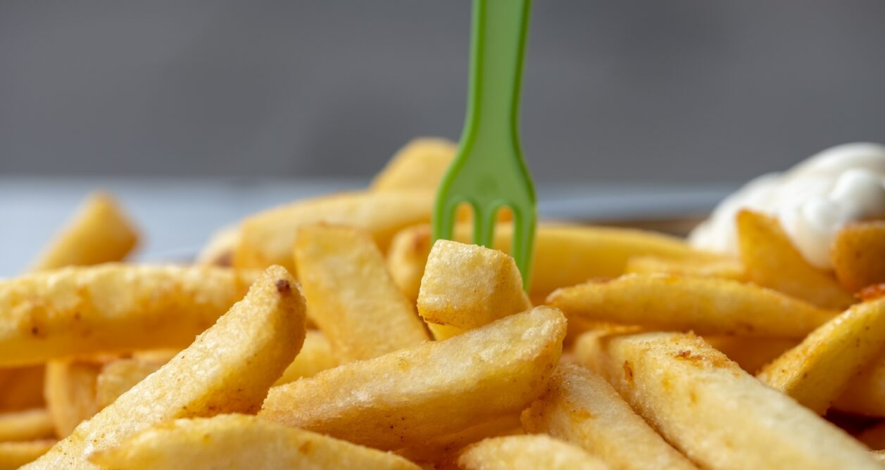 French fries with a green fork