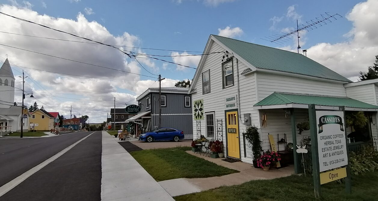 A streetview of the front exterior entrance of Cassidy's Antiques store downtown Maynooth, Ontario.
